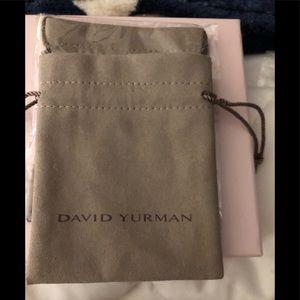10 sizes of Authentic David Yurman pouches.